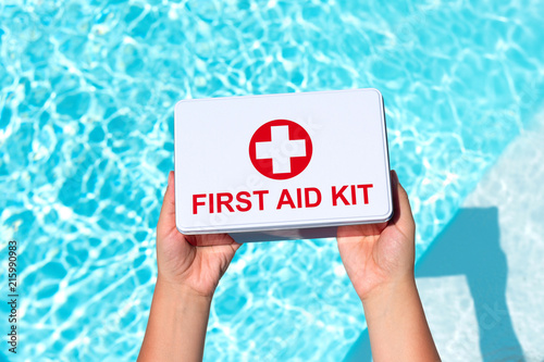 Photo  First aid kit in the female hands. Concept