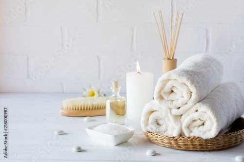 Fotobehang Spa SPA aromatherapy background. Still life with white towel, bath oil, massage brush and candle.