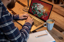 Young Man Playing Poker Via Ne...