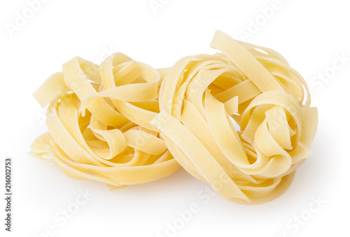 Fotografia Uncooked nests of tagliatelle pasta isolated on white background with clipping p
