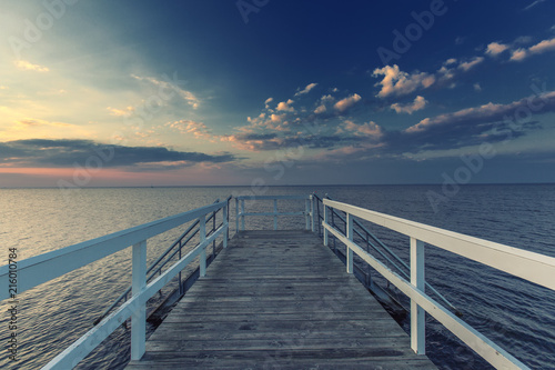 Foto op Plexiglas Panoramafoto s sunset on the sea viewed from wooden pier