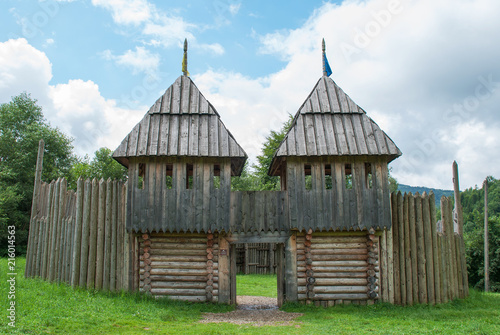 Fotografie, Tablou Wooden fortress towers, reconstruction of old battles, forest lawn