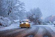 Snow Plow On A Snowy Winters Night