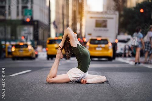 Woman doing yoga pose on city street of New York Canvas Print