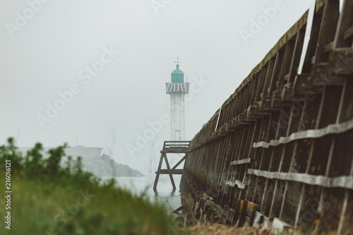 Foto op Plexiglas Poort Pier and lighthouse in the harbour of Deauville on a misty morning in Normandy, France. English channel seascape