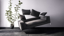 Black Sofa And Potted Plant Floating In The Air