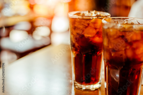 Two glass soft drink with ice in restaurant background Canvas Print