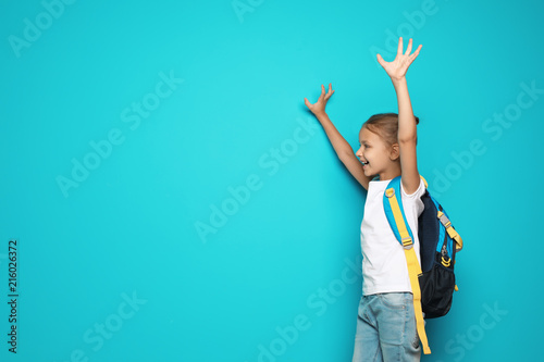2ec585240b Little school child with backpack on color background - Buy this ...