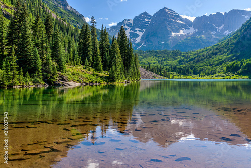 Fotografie, Obraz Maroon Lake - A Spring evening at colorful Maroon Lake, with Maroon Bells rising in the background, Aspen, Colorado, USA