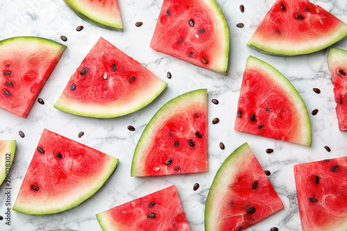 Flat lay composition with watermelon slices on marble background