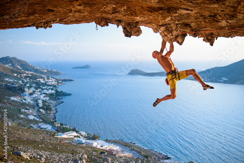 Leinwand Poster Rock climber at Scenic  Rocks  in beautiful golden light on a sunny day