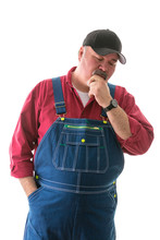 Big Man In Overalls And Cap St...