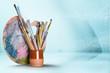 Leinwanddruck Bild - Wooden art palette with blobs of paint