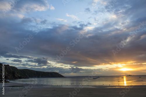 Sunrise over beach Poster