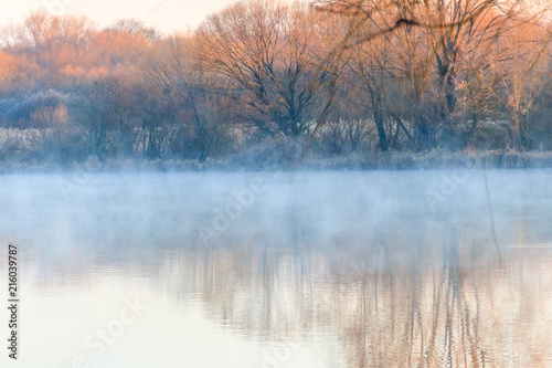 Fotobehang Meer / Vijver Peaceful lake in the mist. Fog over pond at morning