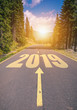 canvas print picture - Empty asphalt road and New year 2019 concept. Driving on an empty road in the mountains to upcoming 2019 and leaving behind old 2018. Concept for success and passing time.