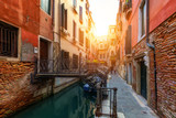 Fototapeta Uliczki - View of the street canal in Venice, Italy. Colorful facades of old Venice houses. Venice is a popular tourist destination of Europe. Venice, Italy.