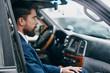 business man driving a car