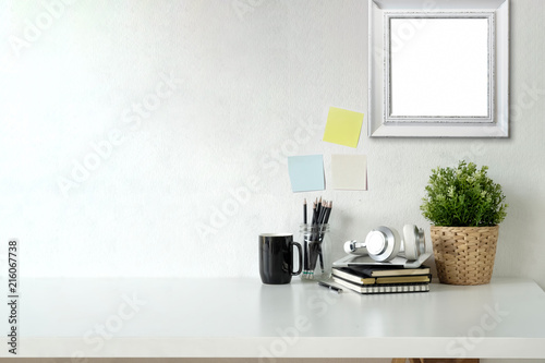 Fotografía  Stylish workspace with mockup poster and gadget
