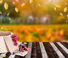 Food Basket With Red Wine For Pinic On Wood Table In Autumn And Fall Harvest Season Holiday. Thanksgiving Background And Copy Space For Text.