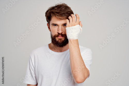 bandaged hand, bearded man Wallpaper Mural