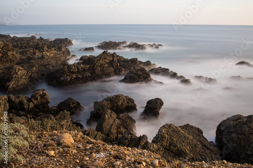 Staande foto Bleke violet Picturesque view of rocks on coast