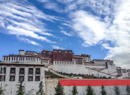 Fotografie, Obraz  Potala Palace in Lhasa day view from town square with blue sky background, Tibet Autonomous Region