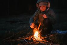 Seven-year-old Boy Light A Fir...