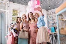 Blonde-haired Woman. Blonde-haired Woman Wearing Blue Shirt And Pink Skirt Making Selfie With Pregnant Friend