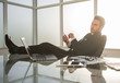 businessman sitting at his Desk during a working break