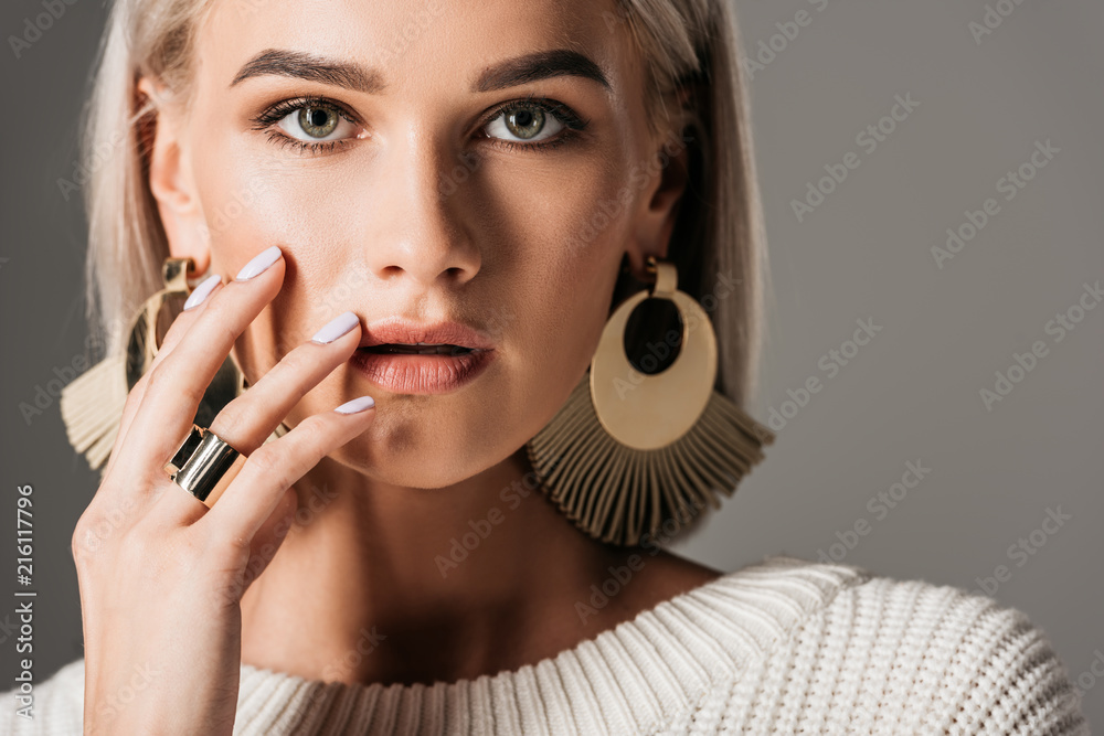 Fototapety, obrazy: attractive blonde girl posing in white sweater and big round earrings, isolated on grey