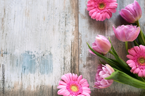 Pink flowers on gray vintage planks