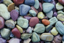 Colorful Pebbles At The Shore ...