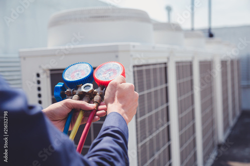 Valokuva  Technician is checking air conditioner ,measuring equipment for filling air conditioners