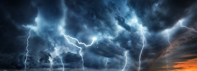 Lightning thunderstorm flash over the night sky. Concept on topic weather, ca...