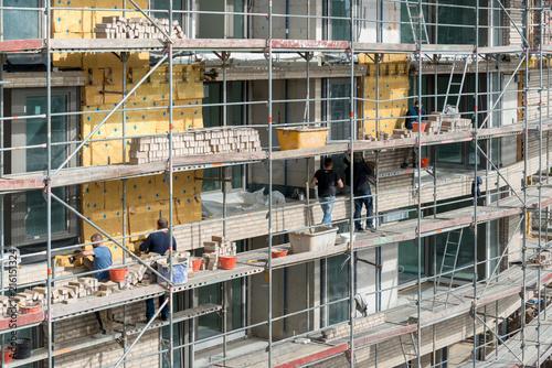Fotografie, Obraz  Fassadenverkleidung eines Neubaus