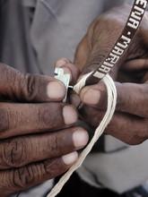 Man Making Bracelet