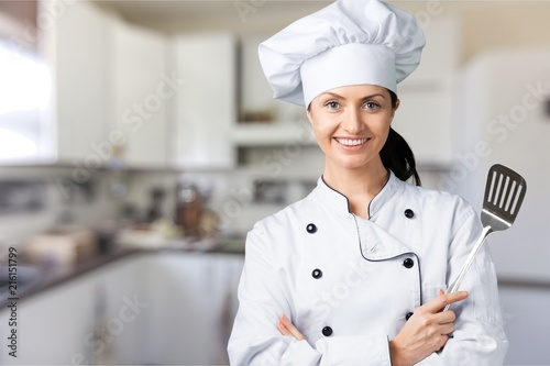 Poster  Portrait of young woman chef on background