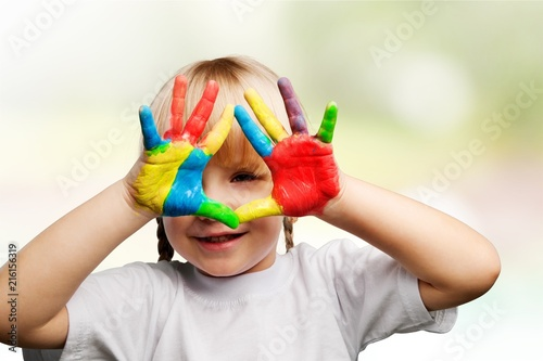 Little girl with hands in paint Poster