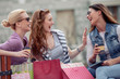 canvas print picture - Portrait of three friends shopping together