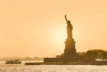 Statue Of Liberty Silhouette In Sunset, New York City, USA.