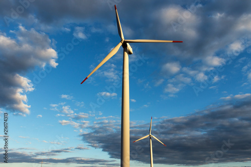 Poster Molens Windmill Turbine - Wind Mill with Beautiful Blue Sunset Sky on Background