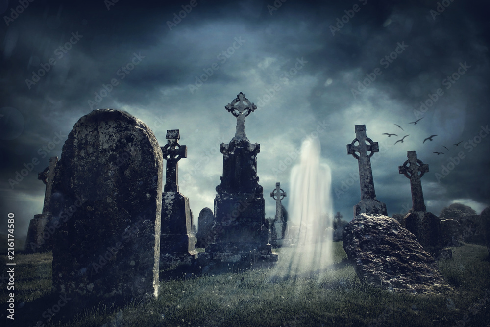 Fototapeta Spooky old graveyard and a ghost