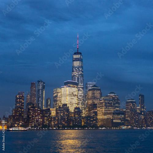Keuken foto achterwand New York City Panoramic view of Lower Manhattan from Ellis Island at cloudy dusk, New York City.