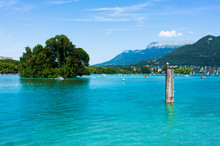 Scenic View Of Annecy Lake Showing Crystal Clear Water A Bollard And Swan Island In France