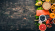 Healthy food. Fish, nuts, fresh vegetables and fruits. On an old wooden table. Top view. Free space for text.