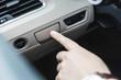 Hand pulling and pushing electric handbrake, Modern car interior.