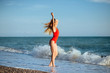 young longhaired girl in red swimsuit