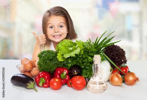 Portrait of adorable little girl preparing healthy food