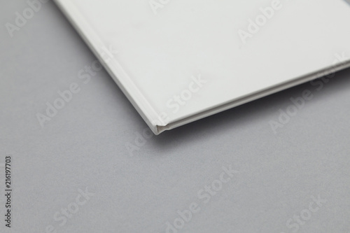 Fototapeta  Hardback book cover mockup. White book on a grey background